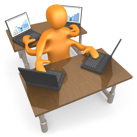 Orange Employee Multitasking While Operating Four Laptop Computers At Two Different Desks In An Office